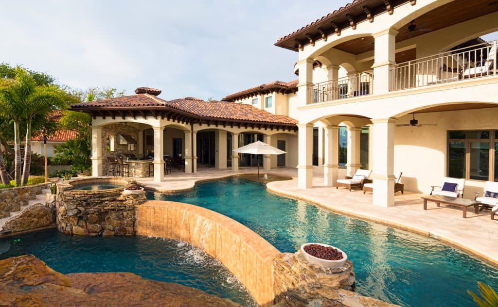 Beautiful view from an estate home overlooking a swimming pool.