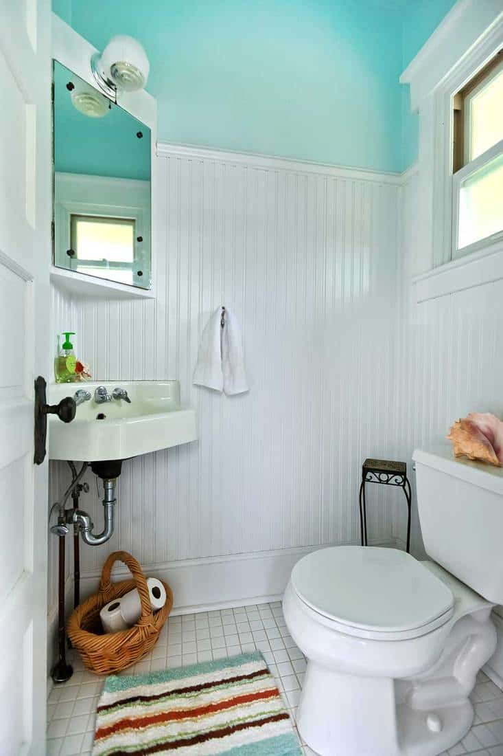 Blue and white old bright small bathroom