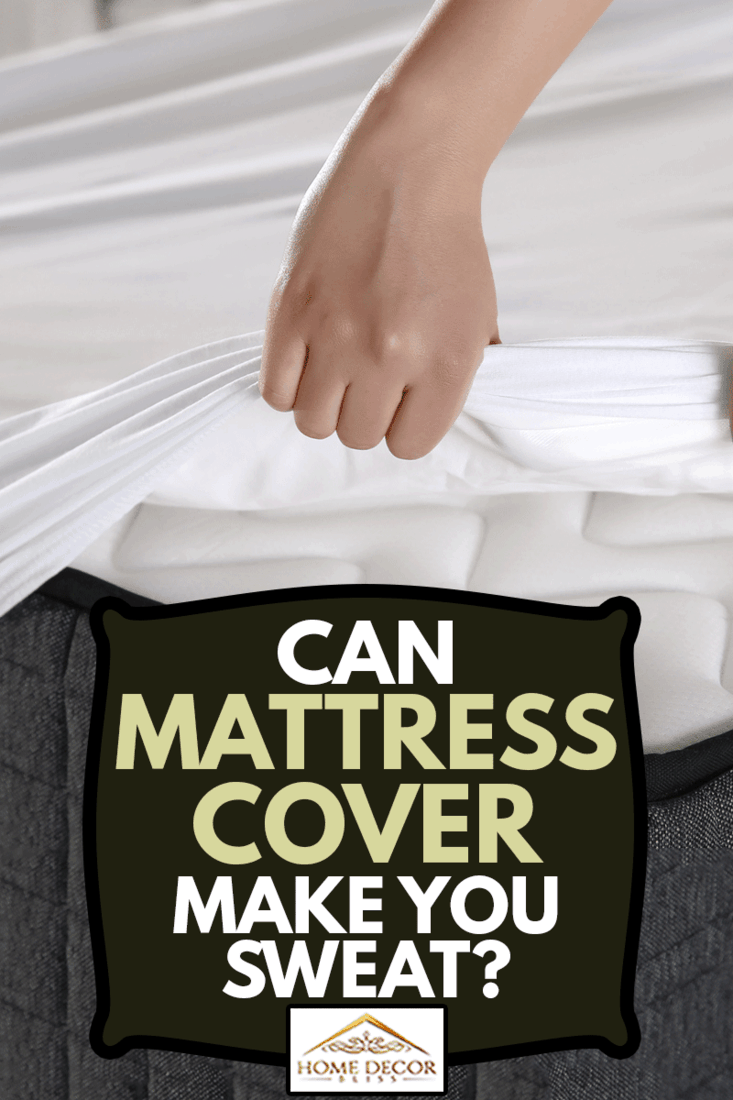 Female hand pulling mattress cover white sheets, Can Mattress Covers Make You Sweat?