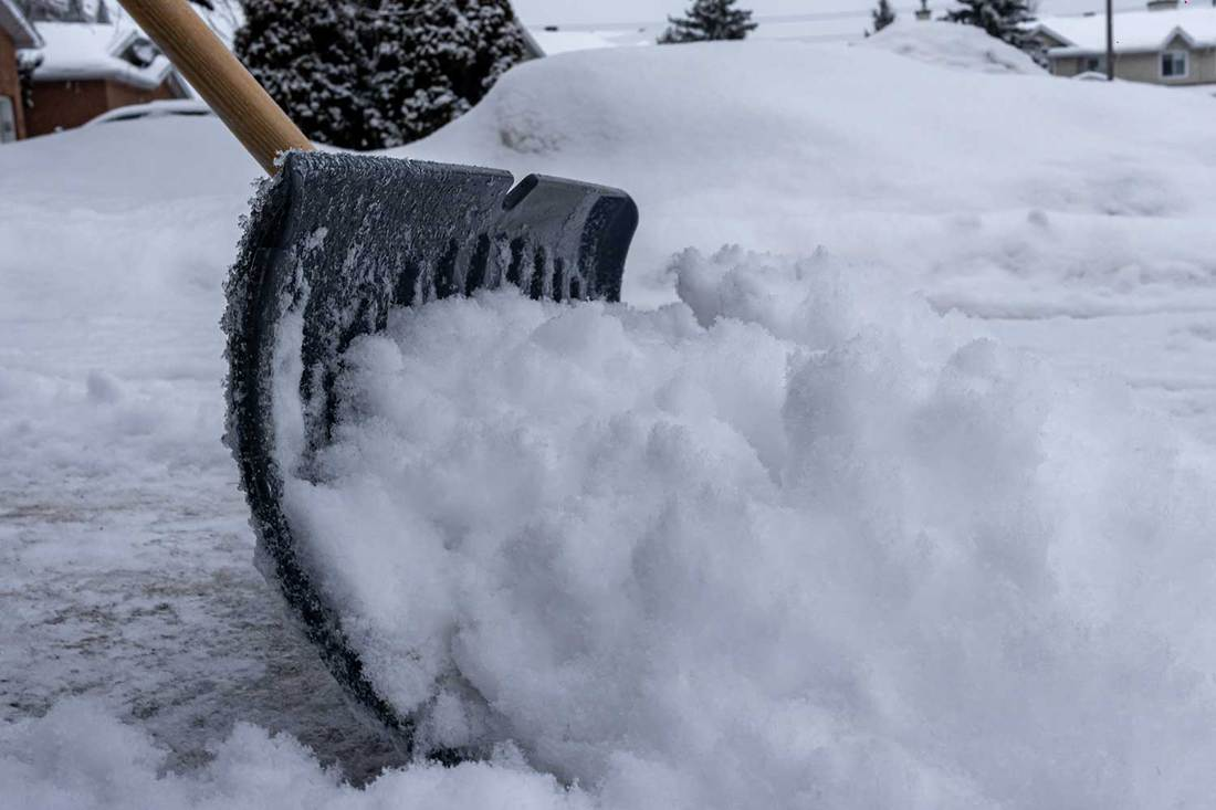 Clearing driveway snow with a shovel