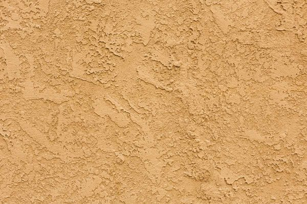 Can New Stucco Get Wet? [And How To Repair Water Damage When It Happens]