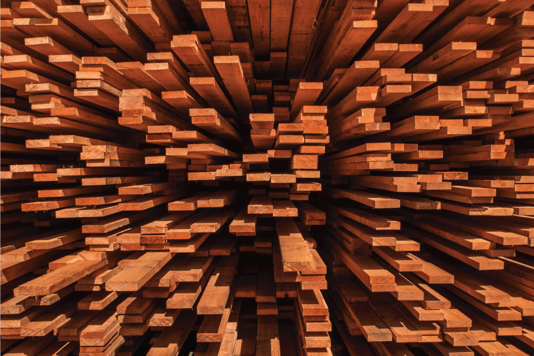 Close-up of stack of just milled redwood lumber