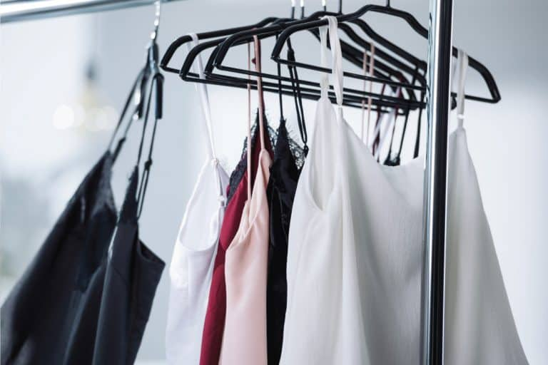 Close-up-shot-of-various-dresses-hanging-on-rack-using-hangers.-5-Places-To-Store-Hangers-In-Laundry-Room, 5 Places To Store Hangers In Laundry Room