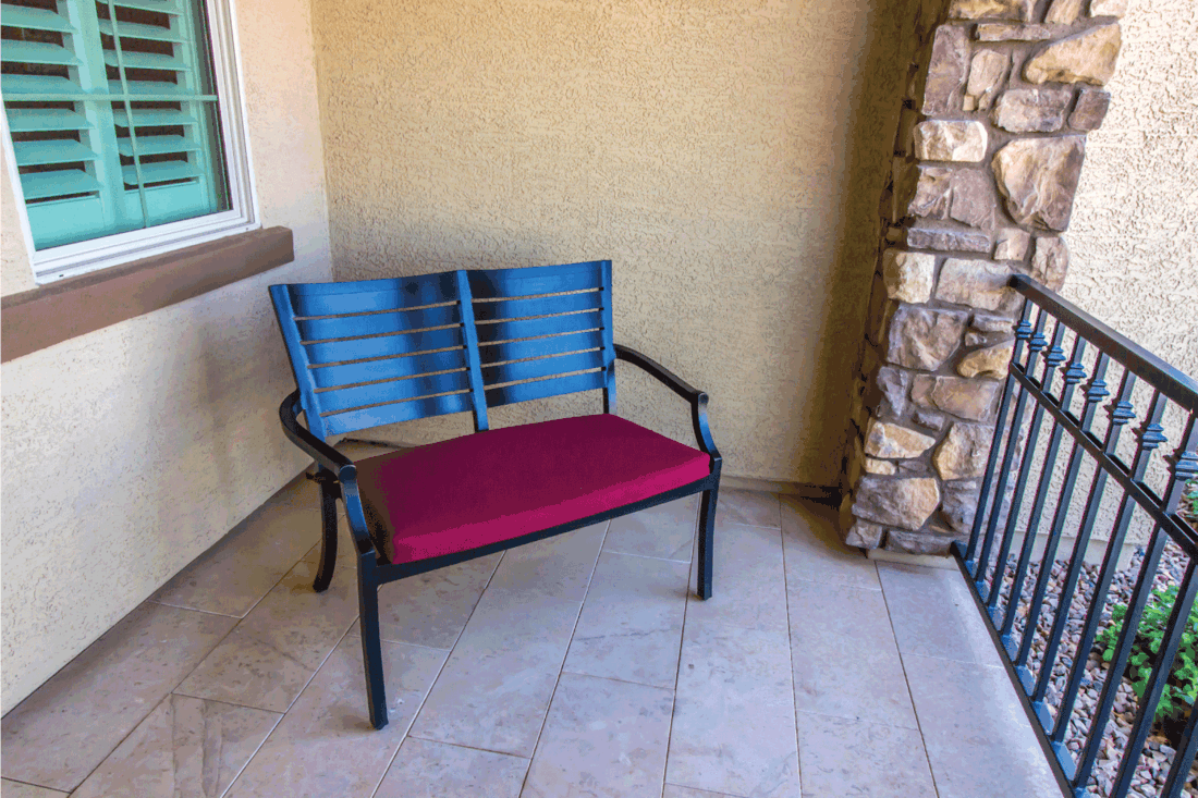 Covered Front Porch With Metal Chair For Two With Red Cushion