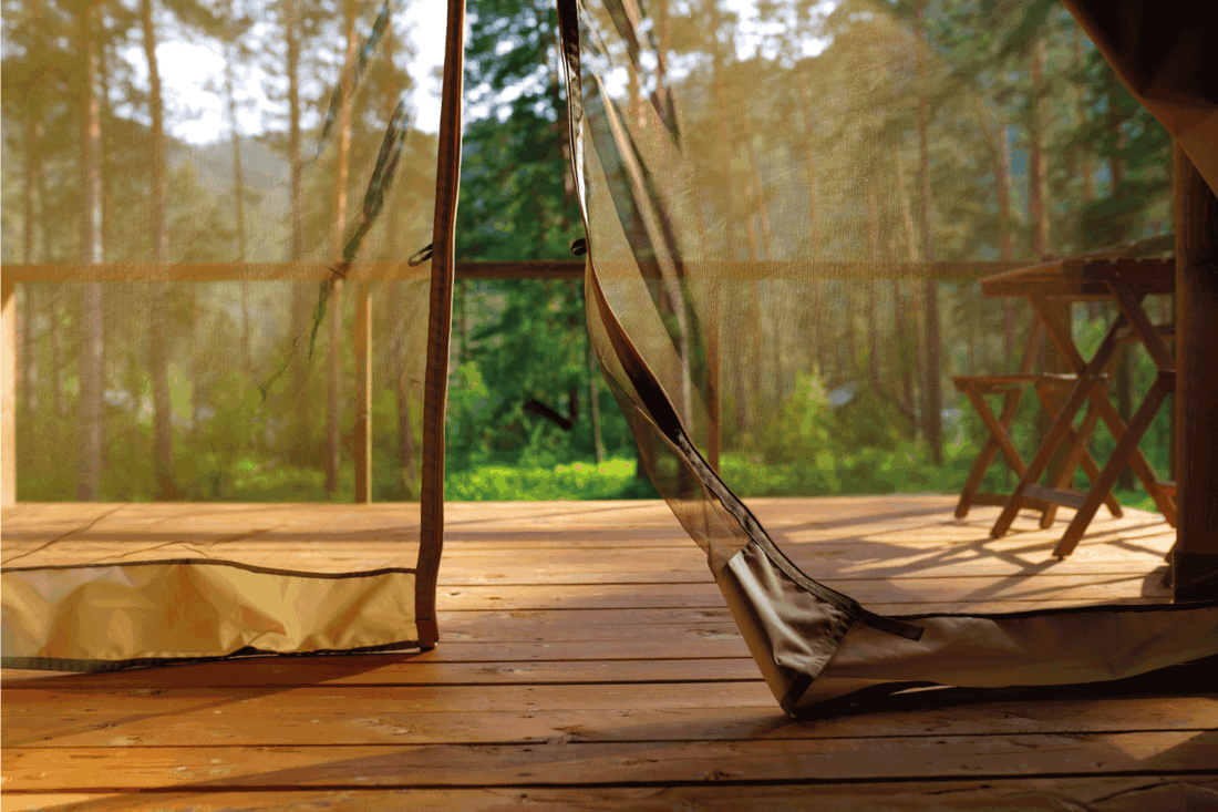 Curtain of a camping tent in the forest