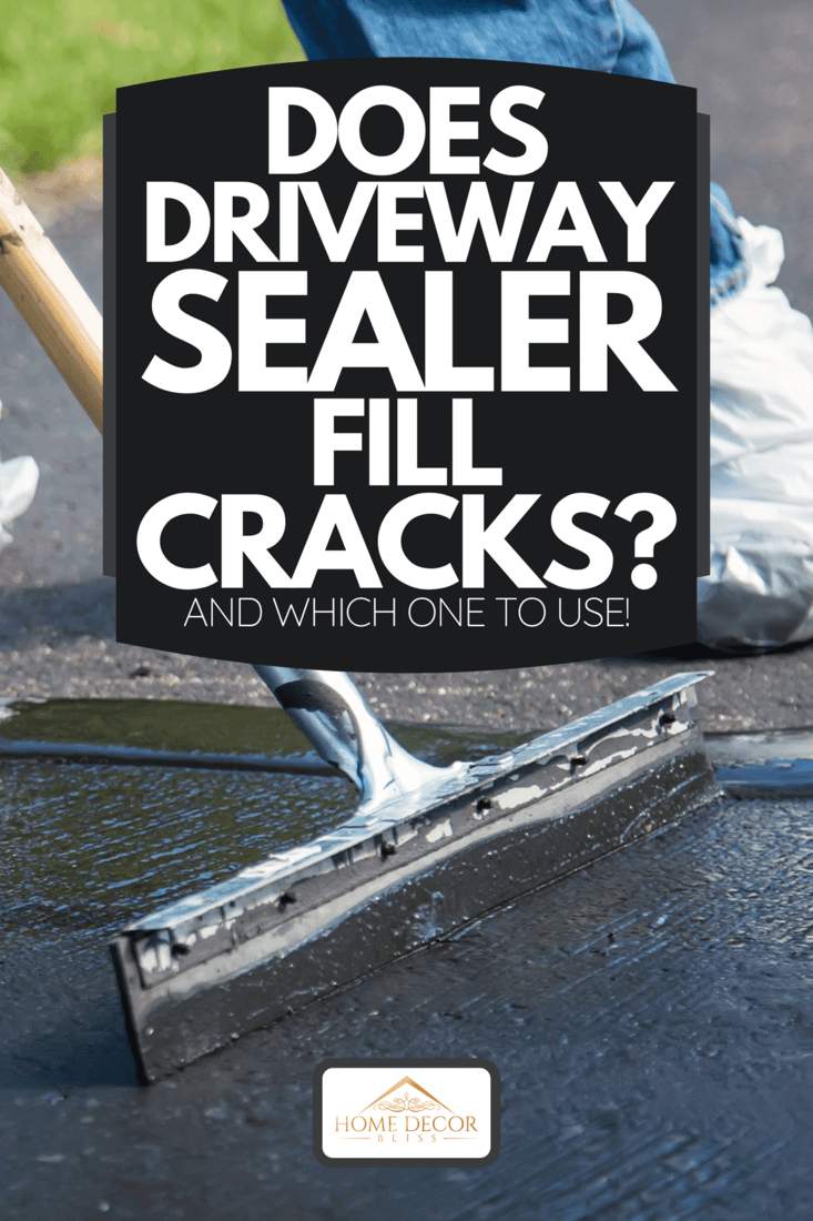 A close-up photo of a home owner seal coating their driveway, Does Driveway Sealer Fill Cracks? [And Which One To Use!]