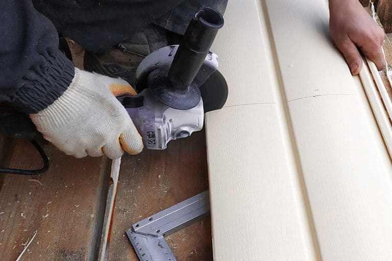 Employee cuts siding to the required size, 10 Of The Best Vinyl Siding Cutters To Check Out