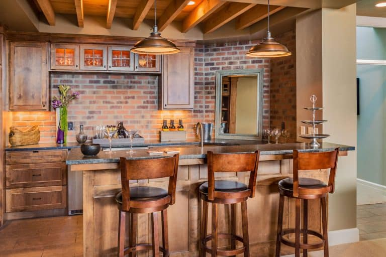 Furnished Bar in New Luxury Home with brick as an alternative for backslash, 8 Backsplash Alternatives To Check Out