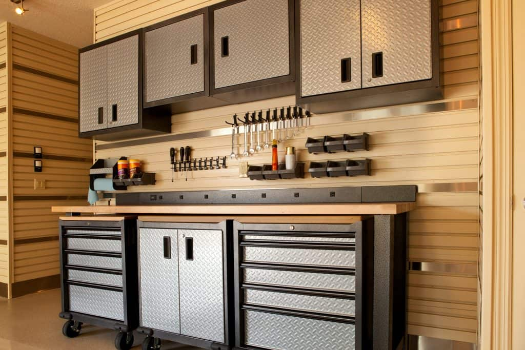 Garage workspace with cabinets, countertop and tool