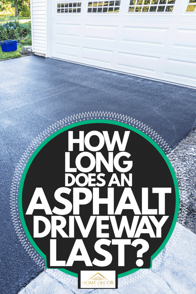 Photo of an asphalt driveway with a huge white painted garage door, How Long Does An Asphalt Driveway Last?