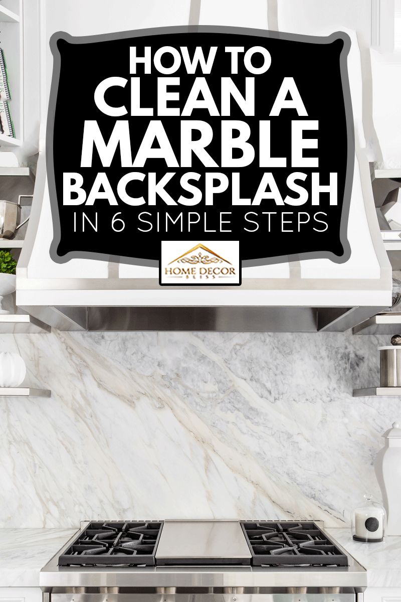 Bright horizontal image of classic white kitchen, with gas range and marble backsplash, How To Clean A Marble Backsplash In 6 Simple Steps