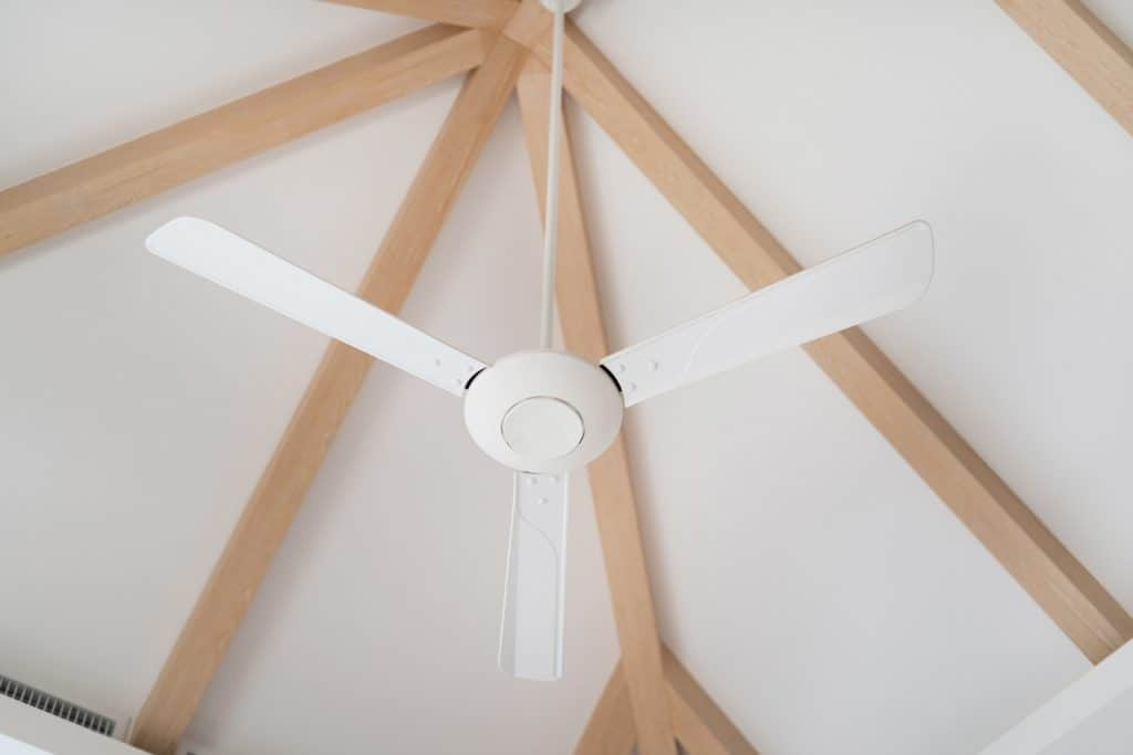 Interior design in luxury villa, house, home, apartment feature white ceiling fan on wooden ceiling