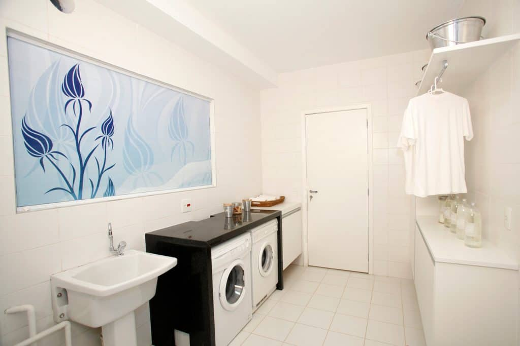 Laundry room with all white tiles