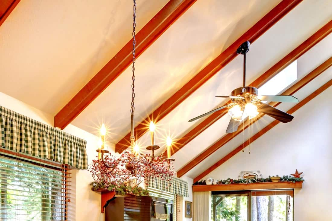 Log cabin house interior with vaulted ceiling and a ceiling fan