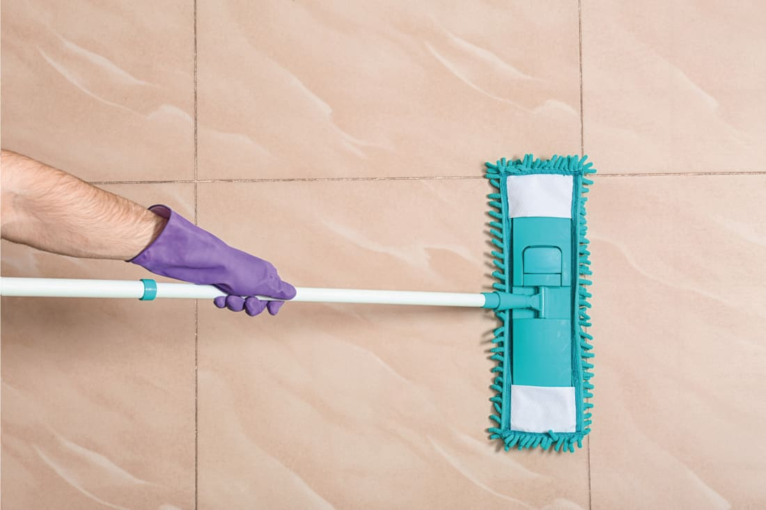 Man cleaning floor with mop, top view. 7 Best Mops For A Bathroom Floor