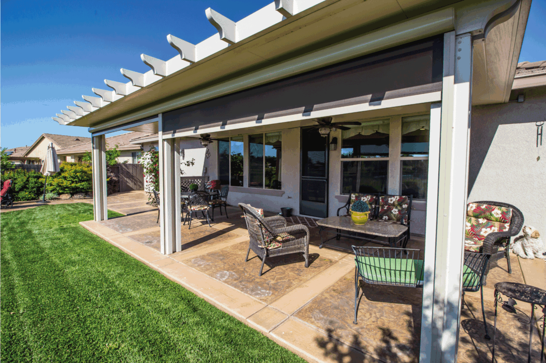Modern Rear Yard Patio With Furniture and automatic sun shades
