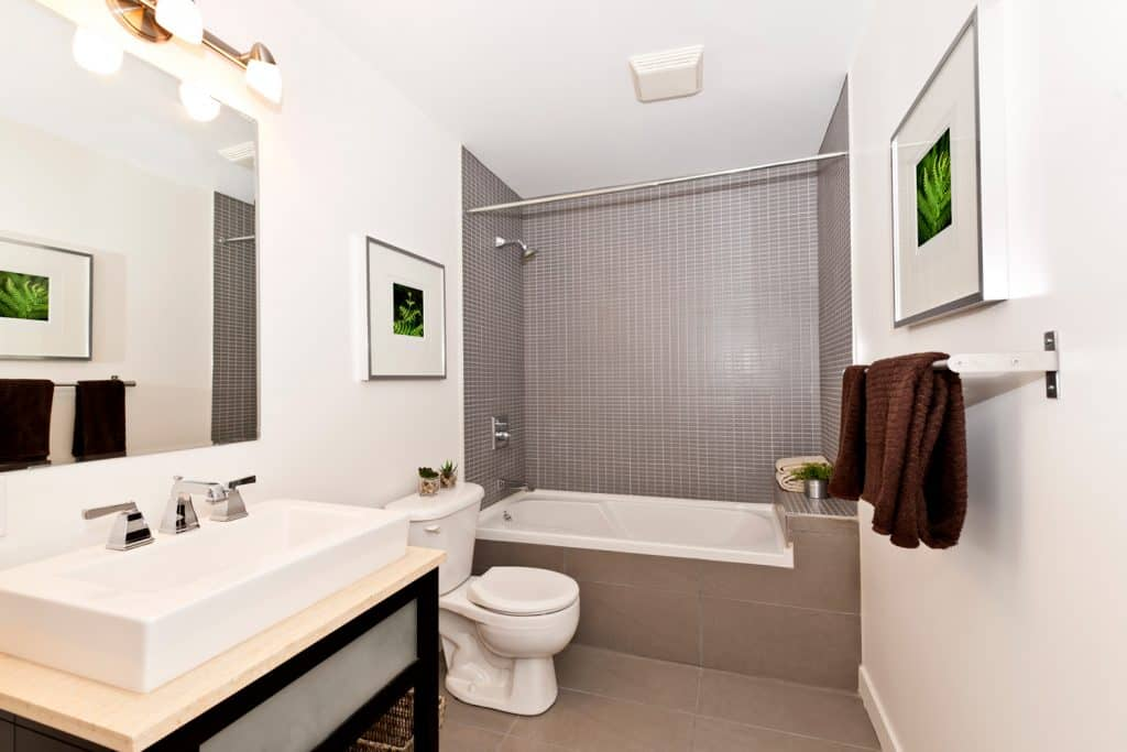 Modern bathroom with hanging picture frames