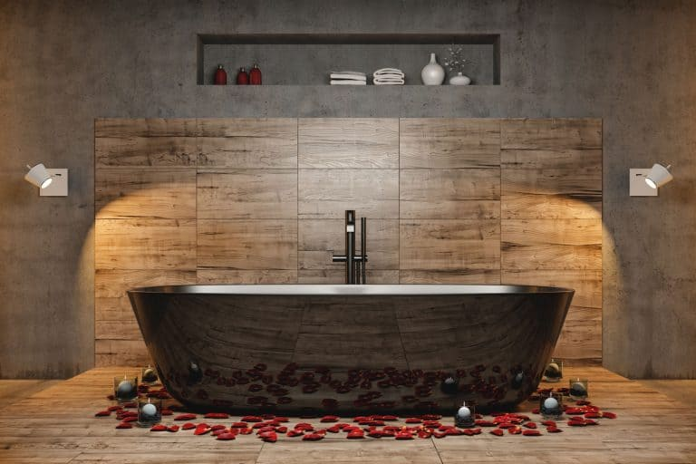 Modern bathroom with large bathtub and a faucet, How High Should A Bathtub Faucet Be?