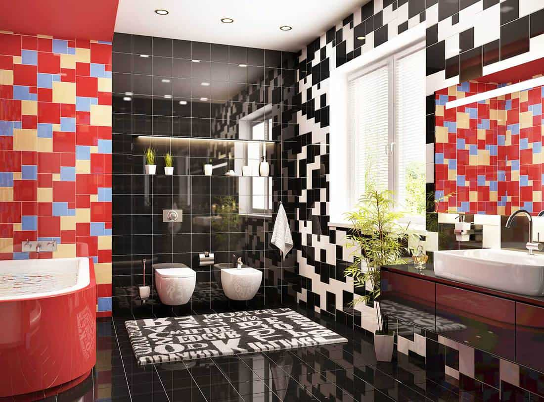 Modern bathroom with window and colorful tiled wall