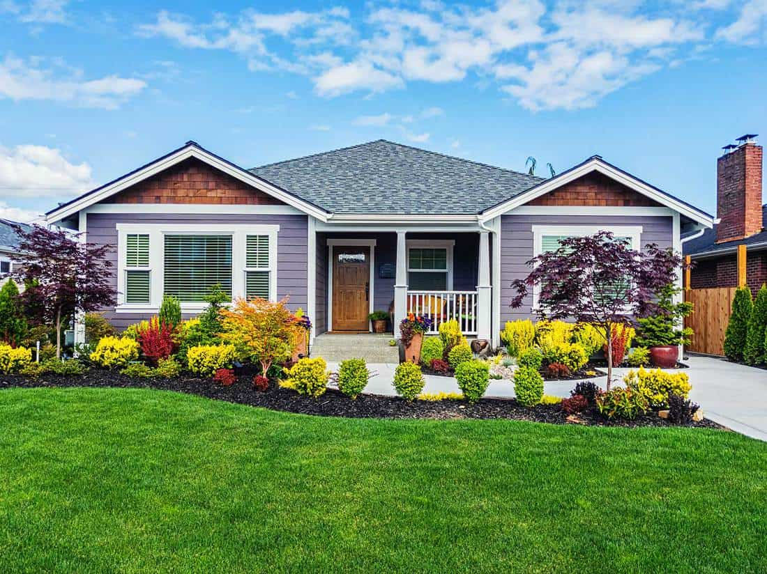 Modern custom single-level suburban home on a sunny summer day