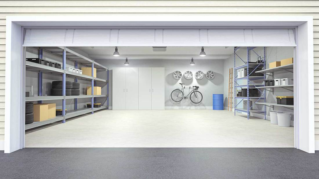 Modern empty garage interior viewing from outside of the open garage door