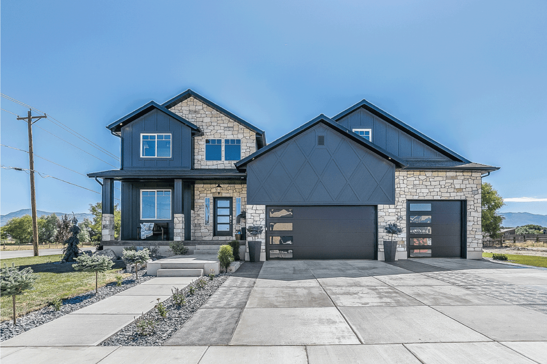 Modern look and colors to traditional architecture of home. matte black modern garage door