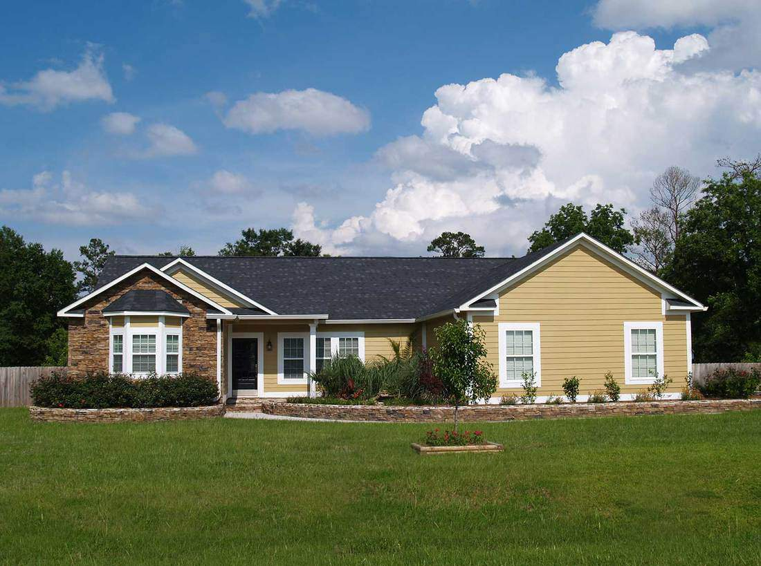 One story residential home with vinyl siding and brick or stone on the facade