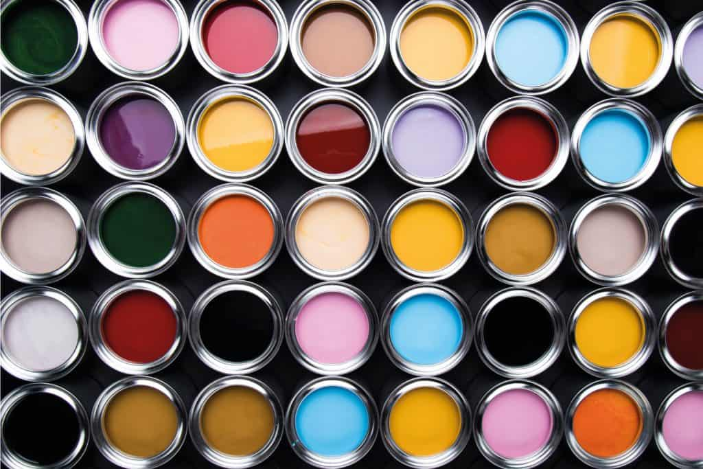 Open cans of paint of different colors. overhead photo