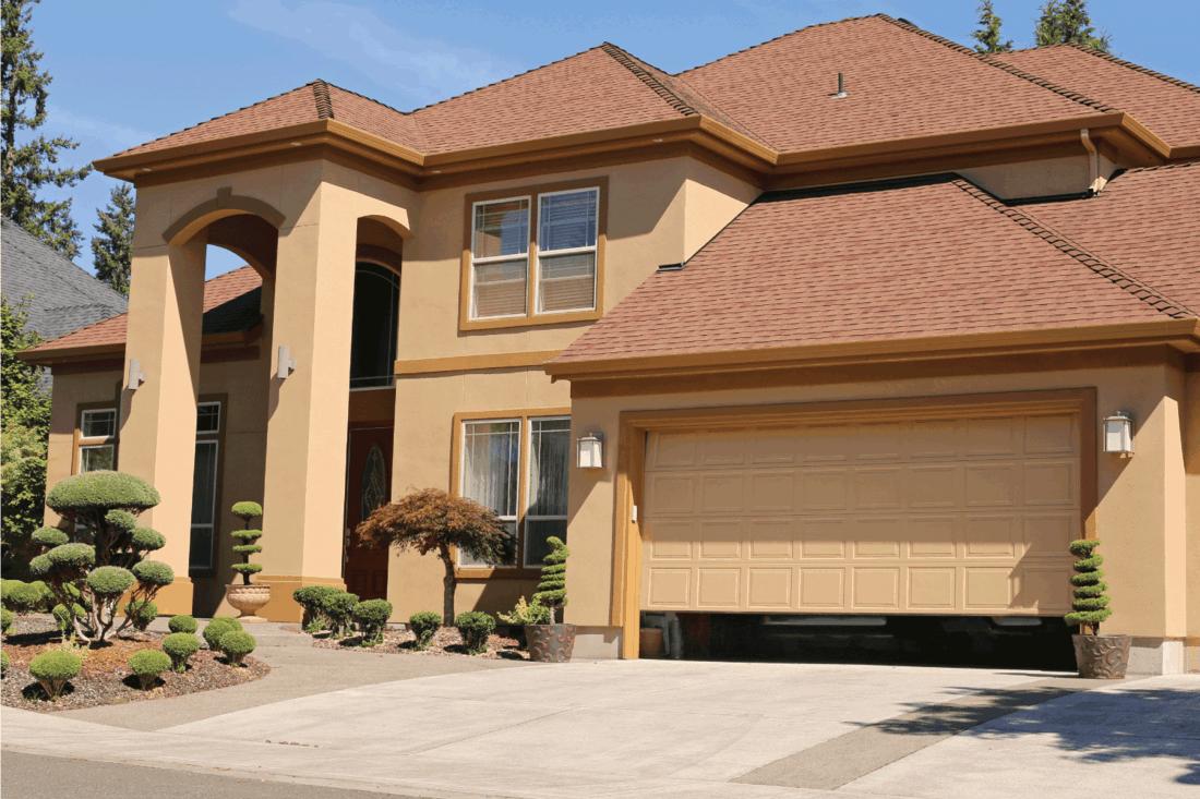 Open garage door in suburban family home .Should You Paint A New Garage Door