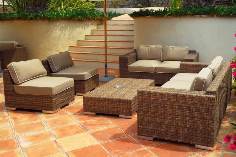 Patio of a villa with wicker furniture, How To Refinish Rattan Furniture In 7 Easy Steps