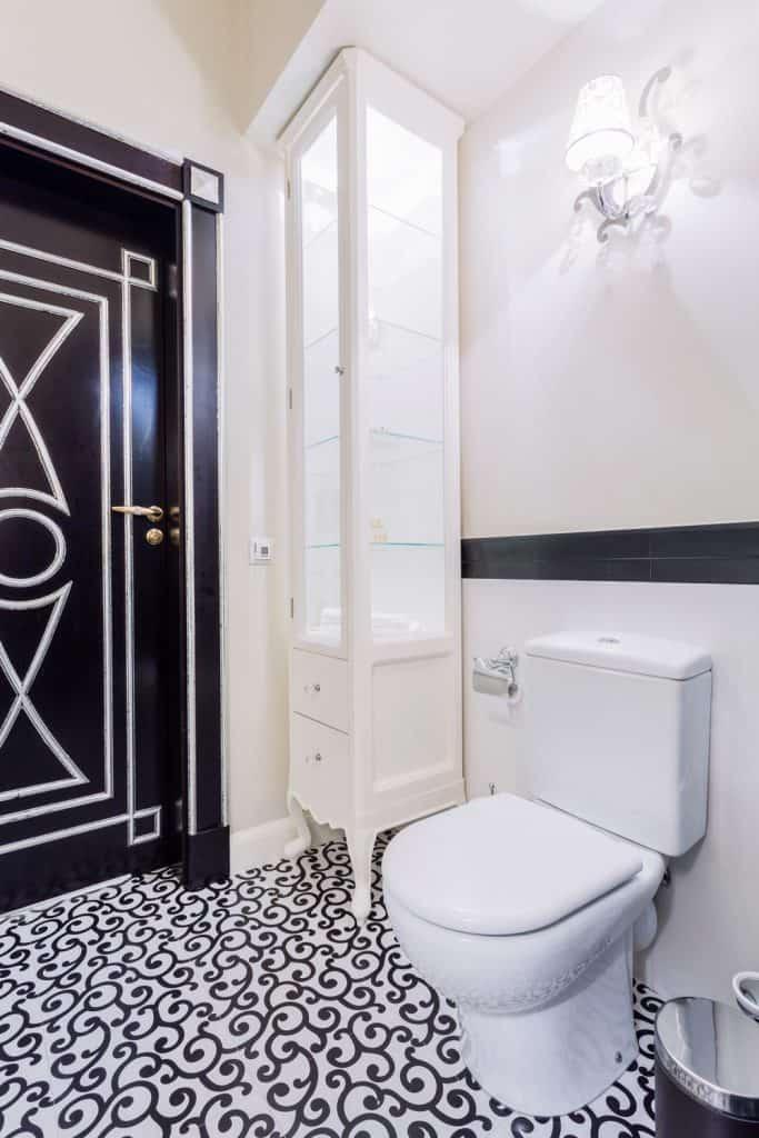 Patterned tiles on the floor in modern toilet