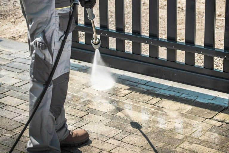 Pressure washing the driveway and gate, Should You Seal Your Concrete Driveway? [A Thorough Look At Pros And Cons]