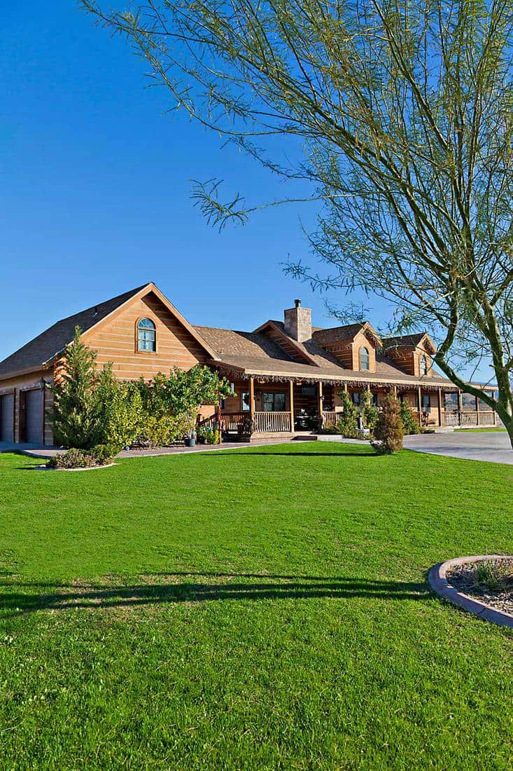 Ranch home exterior with large yard and driveway