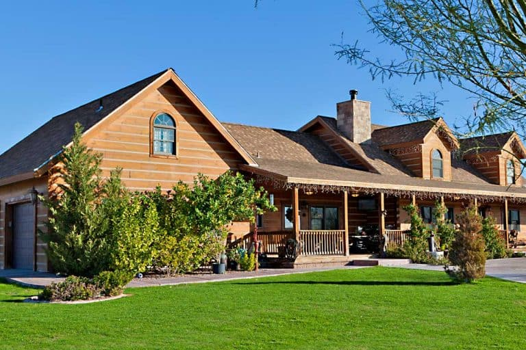 Ranch home exterior with large yard and driveway, 21 Ranch House Color Ideas To Inspire You