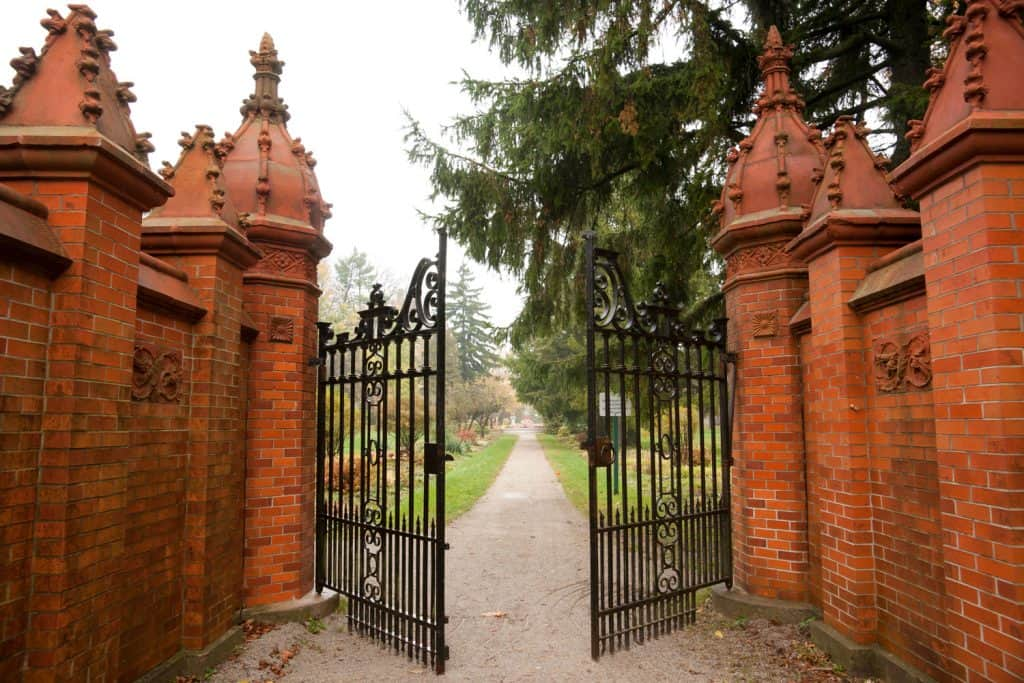 Red Brick gates open to a path and a garden