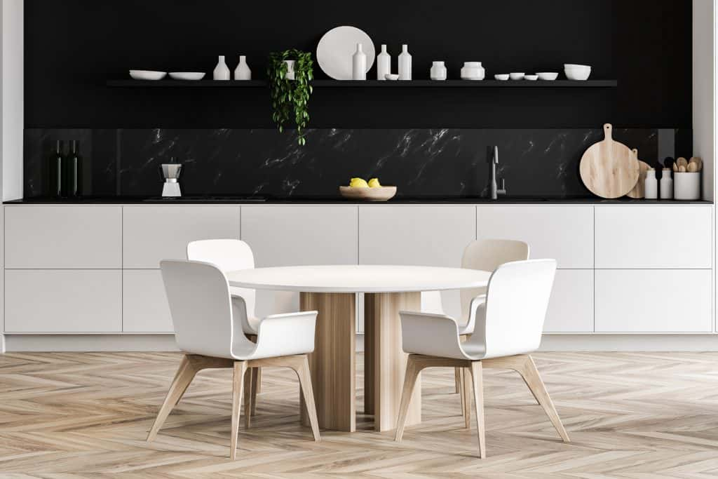 Round dining table in black marble kitchen