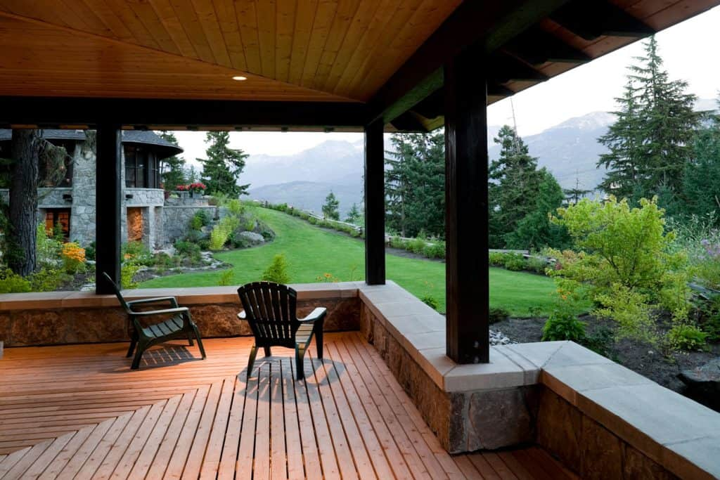 Rustic inspired veranda with metal post and a scenic view