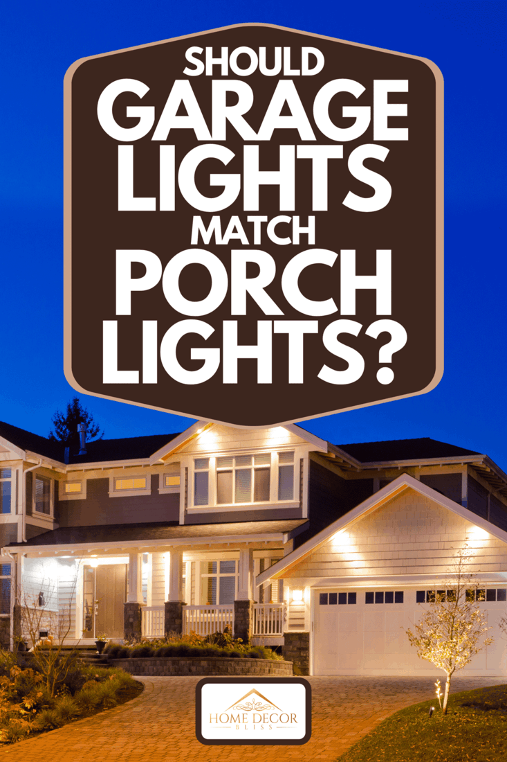 A luxury house at dusk with outdoor lights on, Should Garage Lights Match Porch Lights?