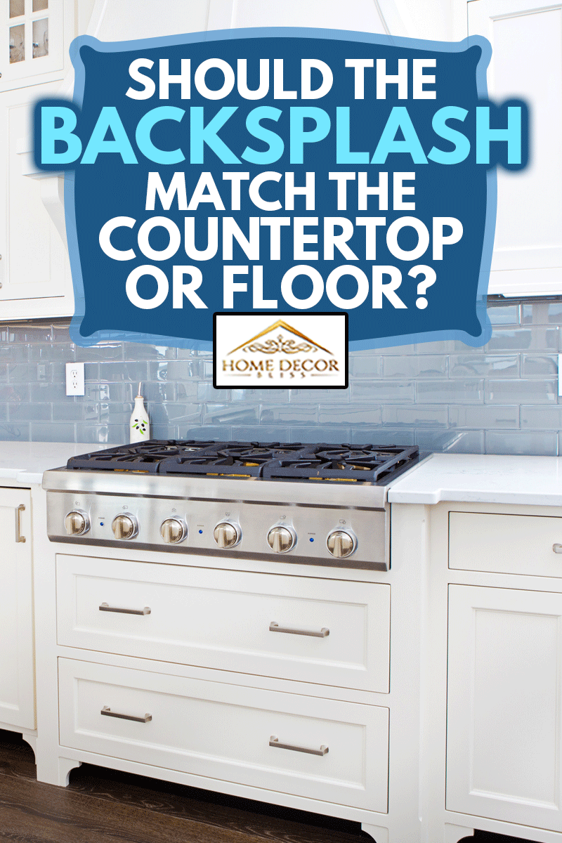 A contemporary home kitchen with stainless steel appliances and painted white cabinets, Should The Backsplash Match The Countertop Or Floor?
