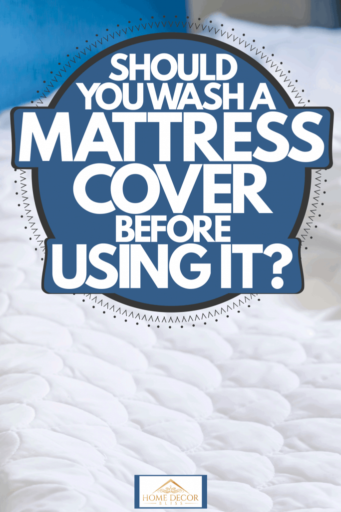 A mattress cover inside a blue colored bedroom, Should You Wash A Mattress Cover Before Using It?