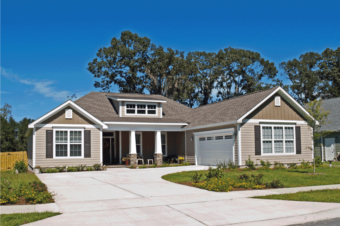 Single story home with garage and tan siding. craftsman ranch