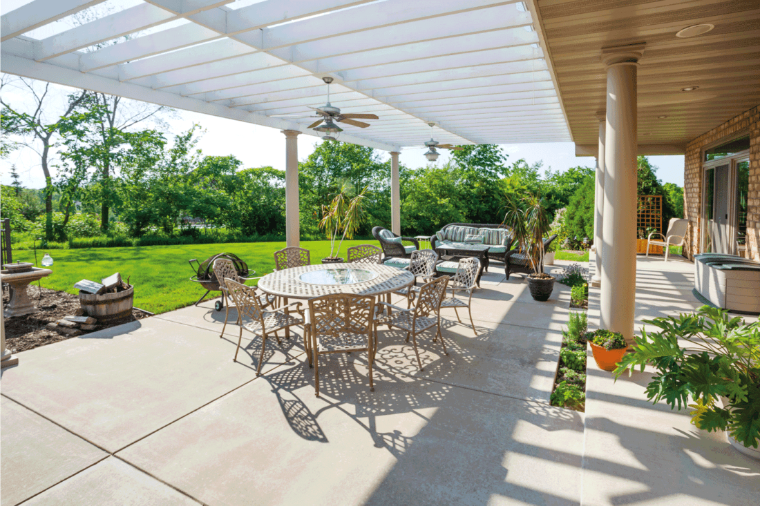 Sunny Patio With Large Pergola, concrete tiles used on the porch