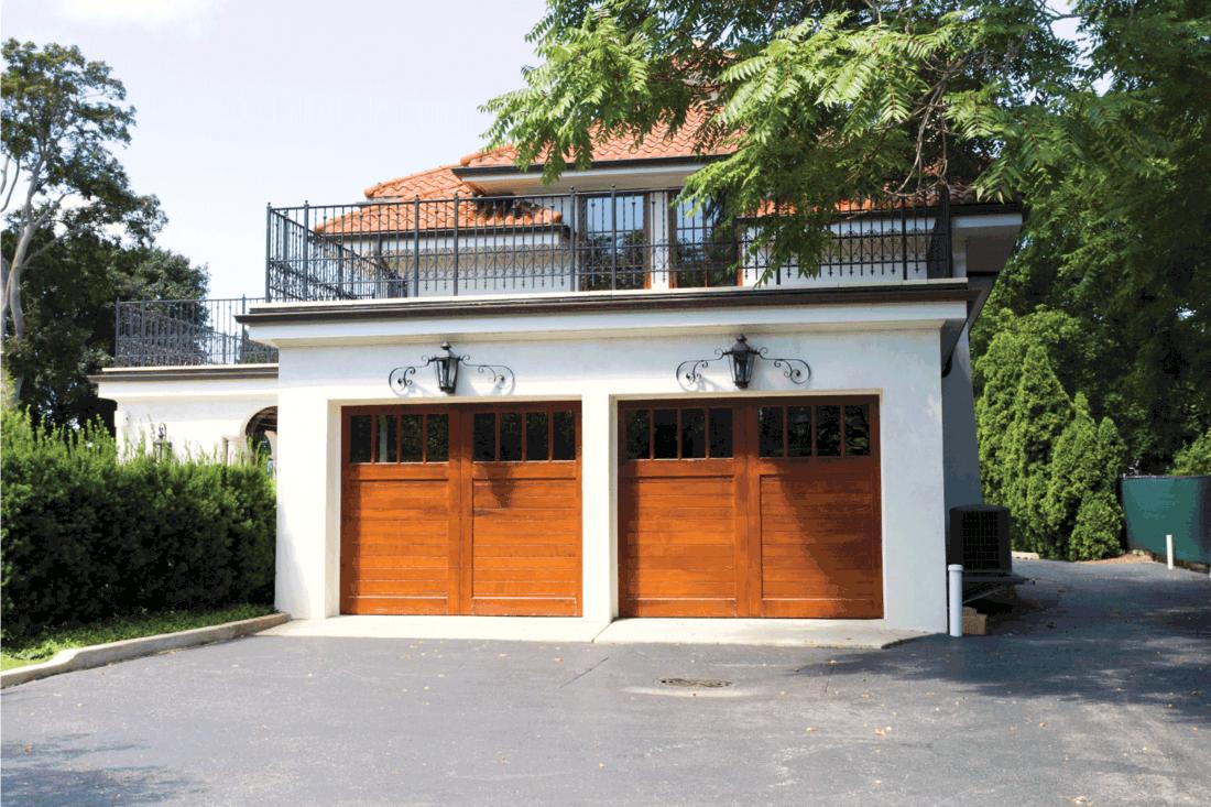 Traditional American Garage With Dark Wooden Door