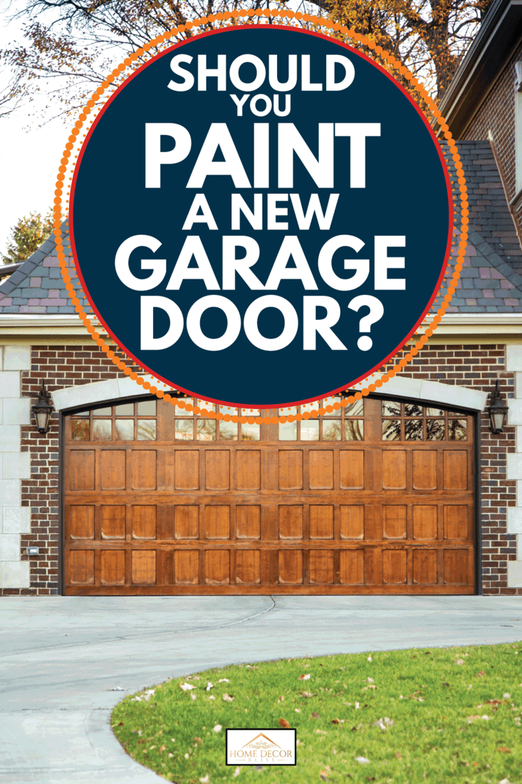 Two car wooden garage in a brick house with clay roofing. Should You Paint A New Garage Door