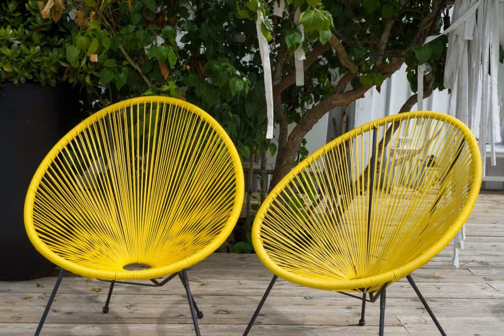 Two yellow lounge chair placed outdoor