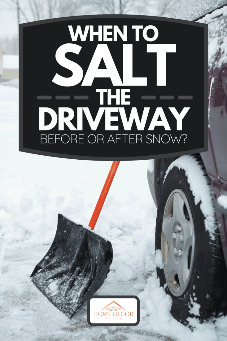A shovel on a driveway during winter snow, When To Salt The Driveway - Before Or After Snow?