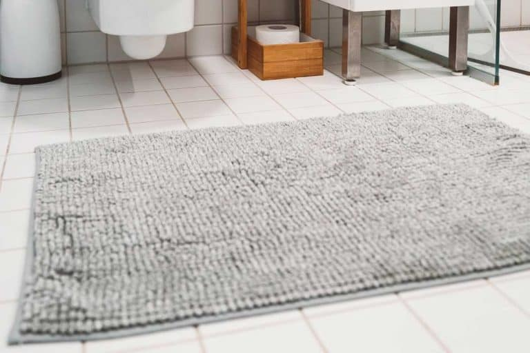 White tiles in a modern small bathroom with gray bath mat, 8 Best Non-Slip Bathroom Floor Mats For Elderly