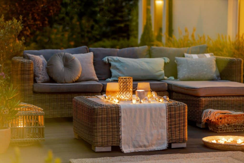 A gorgeous set of wicker chairs and rattan coffee tables outdoor, Can Rattan Furniture Get Wet And Does It Get Moldy?