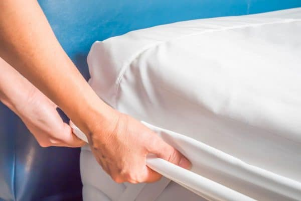 How To Keep A Mattress Cover From Sliding [8 Nifty Techniques!]