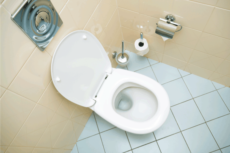 clean toilet in a bathroom with light blue tile. Do Toilets Lose Flushing Power Over Time [And How To Increase Flush Pressure!]